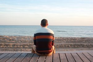 Man looking at ocean contemplating sperm donation | Fertility Specialists Medical Group | San Diego
