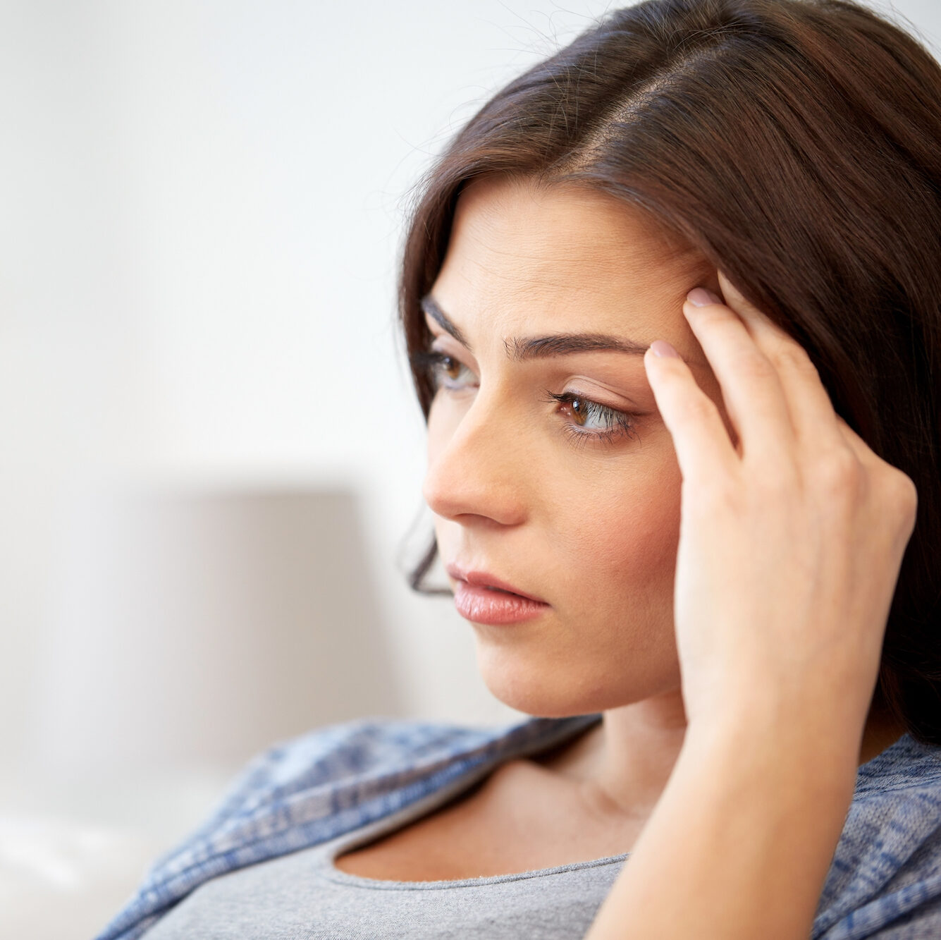 Woman looking at a negative pregnancy test because she didn't know how to time intercourse | Fertility Specialists Medical Group | San Diego, CA