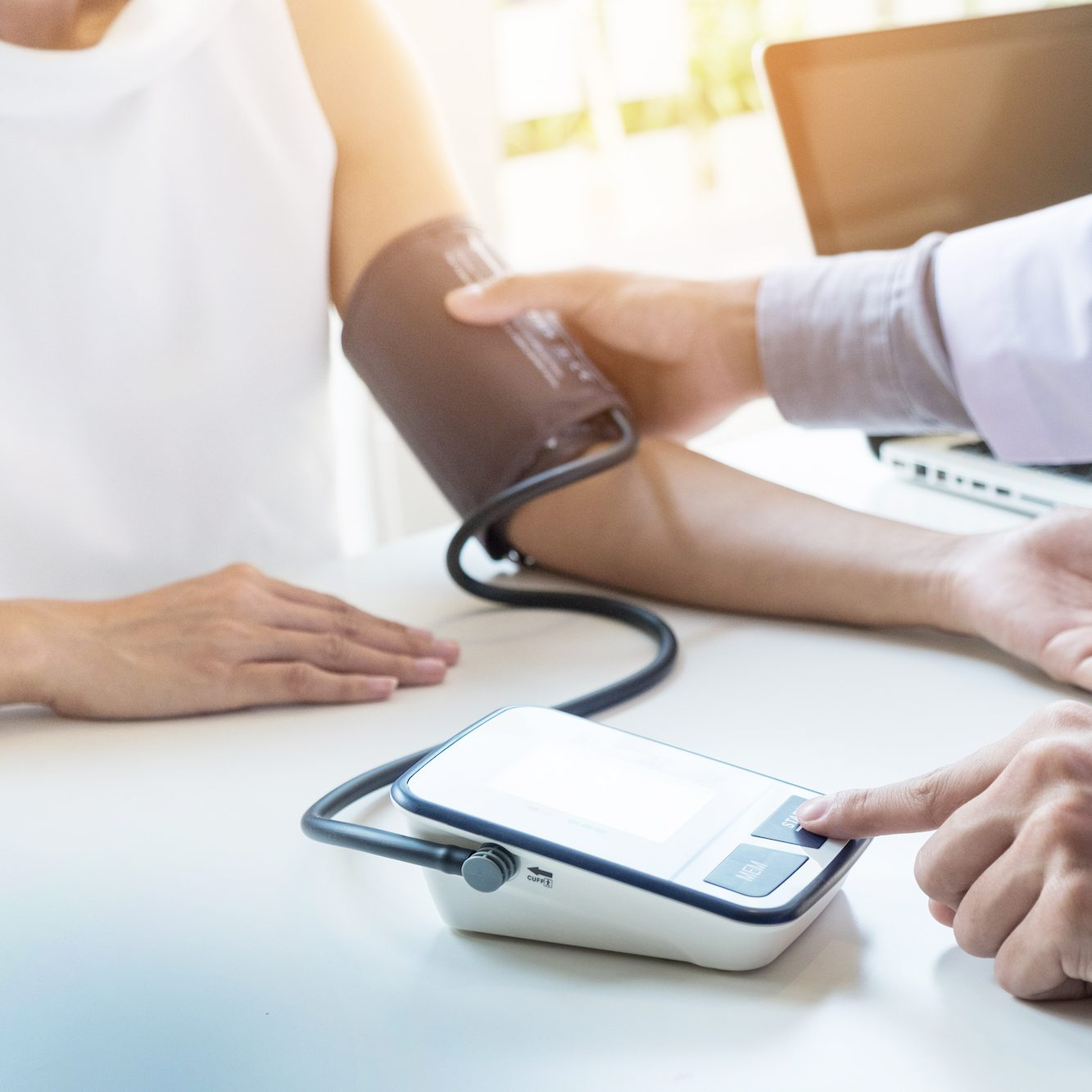 Woman have her blood pressure checked while applying for our Egg Donation Program | Fertility Specialists Medical Group | San Diego & Carlsbad, CA