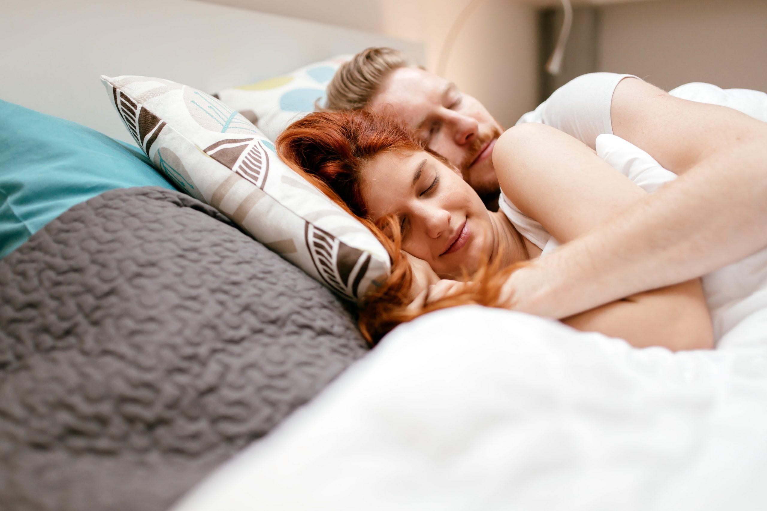 Couple going through infertility sleeping