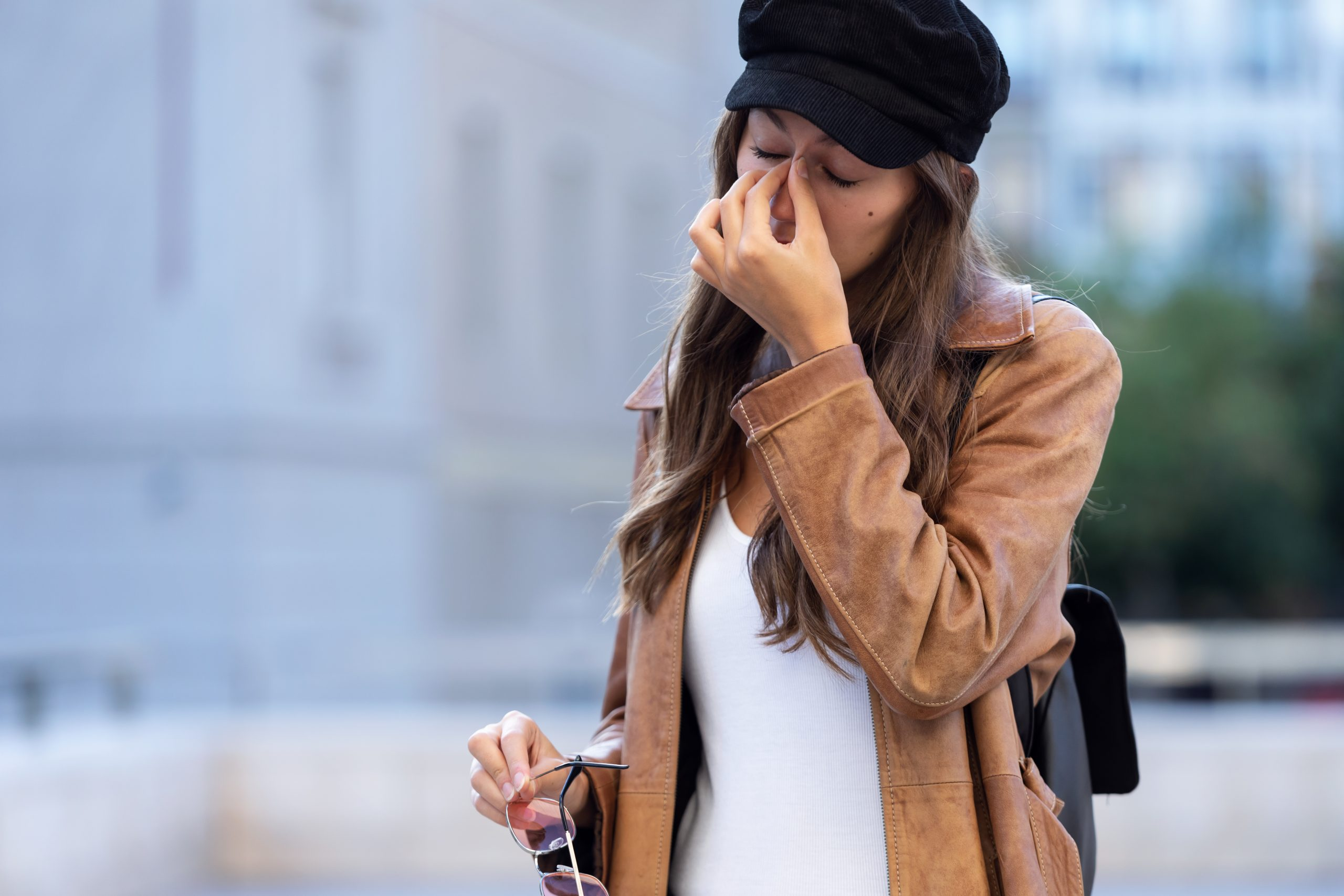 Young woman suffering from female infertility hand on face