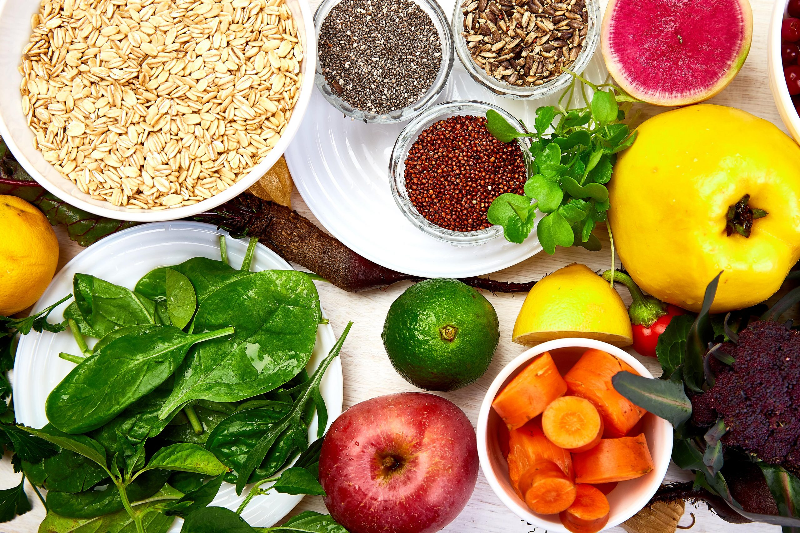 Table of whole grains, leafy greens, and legumes. Foods to alleviate the symptoms of PCOS