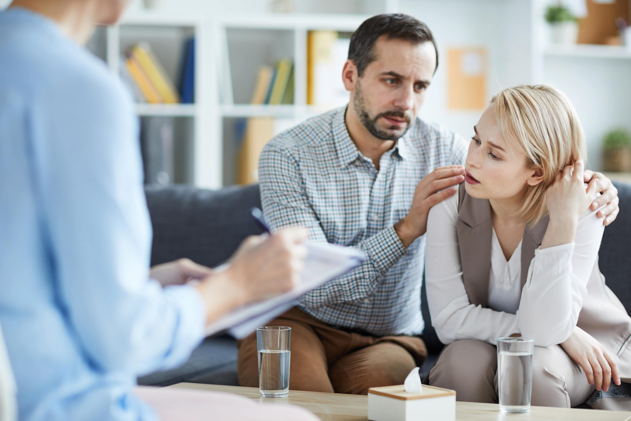 Stressed wife and husband at fertility consultation discussing mental health