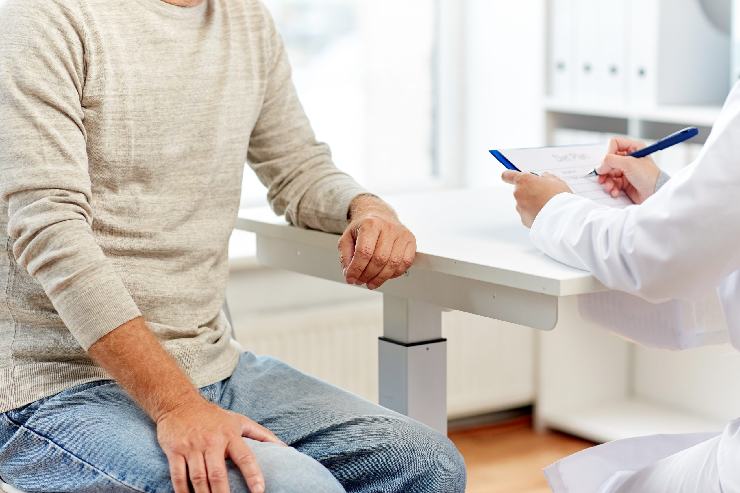 Male with doctor learning of sperm count